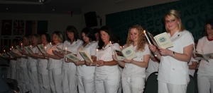 Goodwin's newest Nursing grads recite their oath by candlelight.
