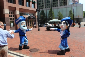 Ebb and Flo dance it up in Constitution Plaza during a Hartford visit from the Goodwin Crash Crew in August.
