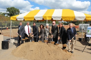 Lt. Gov. Nancy Wyman is in the center as dignitaries break ground on the Pathways Academy for Technology and Design.