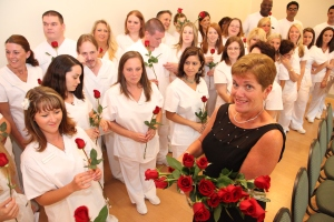 Program Director Jan Costello with graduating nurses at the August. 2012 pinning.