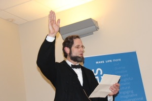 President Abraham Lincoln, as reenacted by Howard Wright, reads his Emancipation Proclamation at Goodwin College.