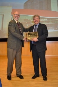 Professor Michael R. Willig, Director of the University of Connecticut Center for Environmental Science and Engineering, congratulates Goodwin College President Mark Scheinberg on his Environmental Leadership Award.