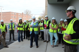 Goodwin employees get a briefing on progress on the remodel and renovation of 403 Main St.