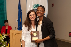 Child Study Program Director Lori Blake presents 2013 Valedictorian Dena Booker with the Academic Excellence Award at a ceremony held on May 30.