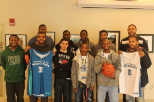 The Navigators basketball team stands for a photo prior to heading to a winter tournament in Boston. Through the new athletics grant, other Goodwin teams and clubs will also be able to travel and get uniforms.