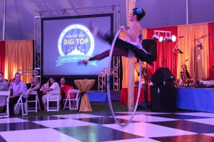 """A performer shows off her hula hoop skills during the College's """"Under the Big Top"""" Gala."""
