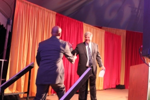 Goodwin President Mark Scheinberg welcomes Nursing student David Mifflin to the stage.