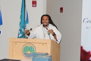 "Commencement Speaker Calvin Terrell, of Phoenix, Ariz., encourages the grads to be ""peaceful warriors."""