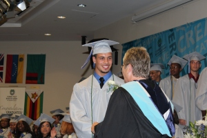 Austin Shelton of Tolland shakes hands with Connecticut River Academy Principal Linda Dodona.