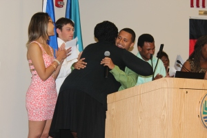 Dahian Rodriguez hugs Summer Bridge English Instructor Tanya Morehead-Cooley during the graduation ceremony.
