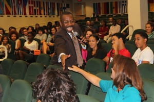Tyrone Black, Goodwin College Concurrent Enrollment Coordinator, shakes hands with audience members.