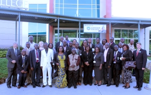 Goodwin officials pose with the Ghanaian delegation of principals outside the College's main entrance.