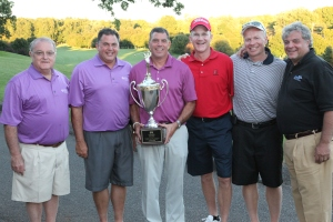 The winning foursome, flanked by Golf Tournament Co-Chair Raymond Solomson Sr, and College President Mark Scheinberg.