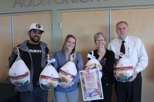 Members of the Community Engagement Committee worked to get the word out about the Turkey Drive.