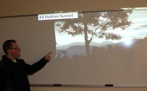 Hoffman showing this beautiful picture of a Haitian sunset during his presentation