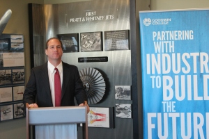 Joe Sylvestro, Vice President for Pratt & Whitney's Manufacturing Operations, speaks at the check  presentation.