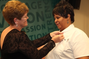 Nursing Program Director Jan Costello pins Jamie Mattos during a ceremony held in December. Mattos, who is now seeking her RN-to-BSN at Goodwin, has become one the of College's most active student poets.